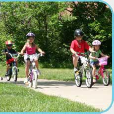 Children riding on the bike path