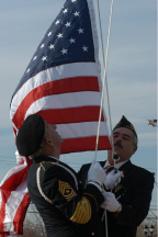 Raising the flag at the dedication ceremony