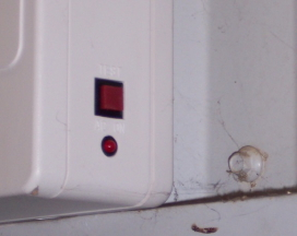 test button on emergency lights