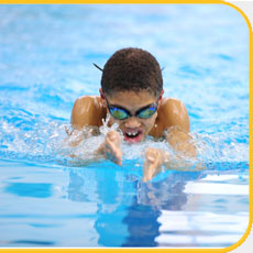 young swimmer doing breast stroke
